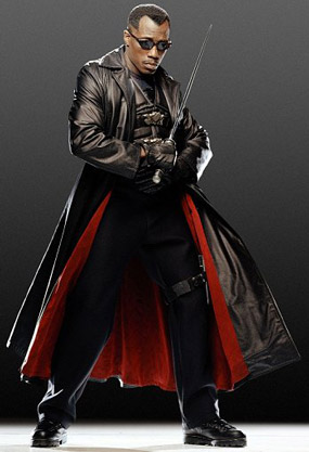 Wesley Snipes as Blade wearing a leather trench coat